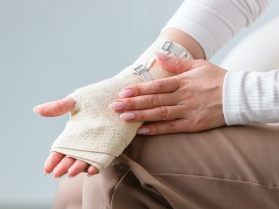 woman-touching-her-wrapped-painful-wrist-with-flexible-elastic-supportive-orthopedic-bandage-after-unsuccessful-sports-or-injury-close-up
